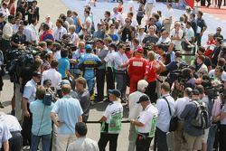 Fernando Alonso and Michael Schumacher talk with the media