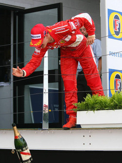 Podium: champagne for Michael Schumacher's team