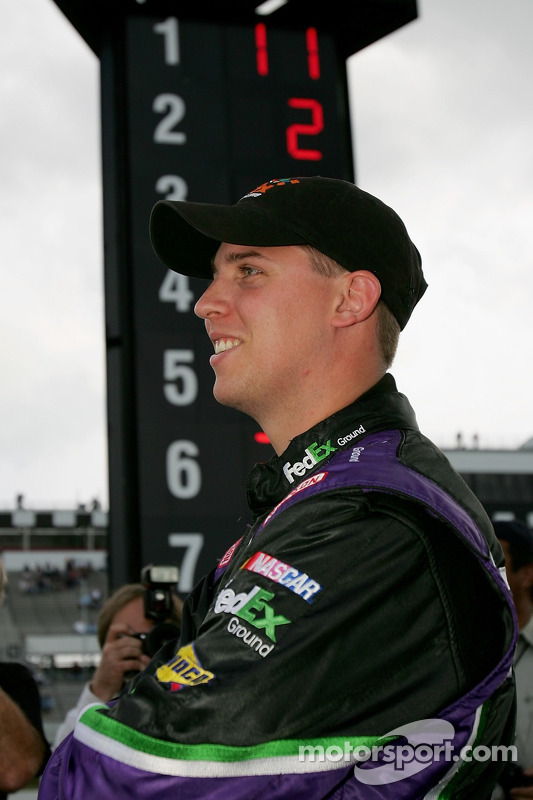 Denny Hamlin watches the final cars as he won the poll during qualifying