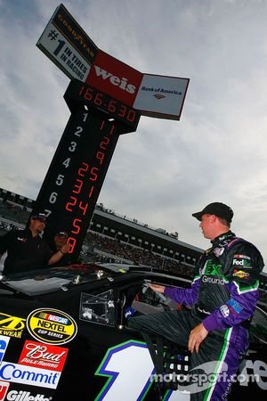 Denny Hamlin steps out of his car after setting the fastest time
