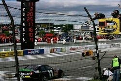 Denny Hamlin takes the checkered flag