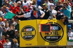 Mario Batalli waves the green flag to start the NASCAR Nextel Cup Series Pocono 500