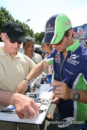 Sébastien Loeb signs autographs