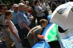 A young fan checks the Pescarolo Sport Pescarolo C60 Judd