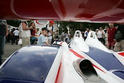 Young fans watch the RML MG Lola EX 264
