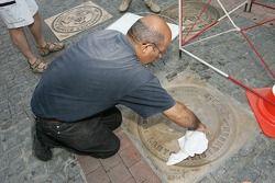 Unveiling of the 2005 24 Hours of Le Mans winners plaque: a man prepares the 'Empreinte des vainqueurs' plaque
