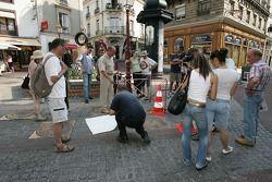Unveiling of the 2005 24 Hours of Le Mans winners plaque: bystanders watch a man prepares the 'Empreinte des vainqueurs' plaque