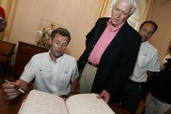 Unveiling of the 2005 24 Hours of Le Mans winners plaque: Tom Kristensen signs the honorary book of