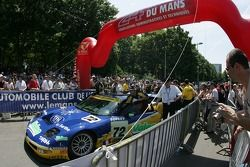 Luc Alphand Aventures team members push the Corvette C5-R to scrutineering
