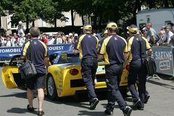 Luc Alphand Aventures team members push the Corvette C5-R through scrutineering