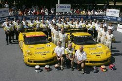 Ron Fellows, Johnny O'Connell, Max Papis, Oliver Gavin, Olivier Beretta, Jan Magnussen and the Corvette Racing Team pose with the Corvette Racing Corvette C6-R