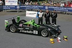 Martin Short, Joao Barbosa, and Stuart Moseley pose with the Rollcentre Racing Radical SR9 Judd