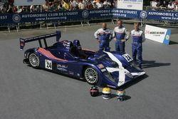 Bill Binnie, Allen Timpany, and Yojiro Terada pose with the Binnie Motorsports Lola 05/42 Zytek