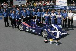 Bill Binnie, Allen Timpany, Yojiro Terada and the Binnie Motorsports Team pose with the Binnie Motorsports Lola 05/42 Zytek