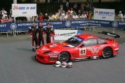Christian Vann, Nigel Smith, and Tim Sugden pose with the Cirtek Motorsport Ferrari 550 Maranello