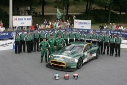 Fabio Babini, Christian Pescatori, Fabrizio Gollin, and the BMS Scuderia Italia Team pose with the BMS Scuderia Italia Aston Martin DBR9