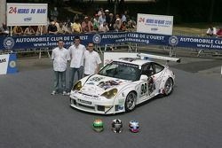 Patrick Bourdais, Tom Cloet, and Adam Sharpe pose with the Noel Del Bello Racing Porsche 996 GT3 RSR