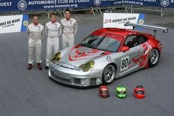 Johannes van Overbeek, Seth Neiman, and Patrick Long pose with the Flying Lizard Motorsports Porsche 911 GT3 RSR
