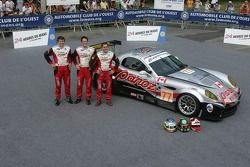 Gunnar Jeannette, Tom Milner, and Scott Maxwell pose with the Multimatic Motorsports Team Panoz Panoz Esperante GTLM