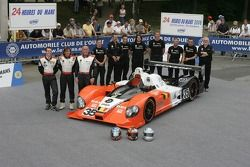 Edward Morris, Jean-François Leroch, Frank Hahn, and the G-Force Team pose with the G-Force Courage C65 Judd