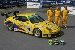 Miro Konopka, Yutaka Yamagishi, and Jean-René de Fournoux pose with the T2M Motorsport Porsche GT3 RSR