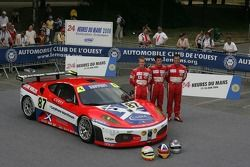 Andrew Kirkaldy, Chris Niarchos, and Tim Mullen pose with the Scuderia Ecosse Ferrari 430 GT