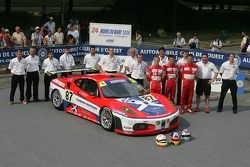 Andrew Kirkaldy, Chris Niarchos, Tim Mullen, and the Scuderia Ecosse Team pose with the Scuderia Eco