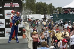 Victory podium: A.J. Allmendinger and Sébastien Bourdais spray the crowd