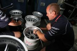 A Williams team member prepares wheels