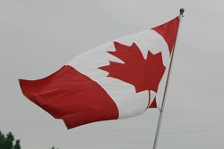 Canadian flag flies in the paddock
