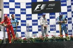Podium: champagne for Fernando Alonso, Michael Schumacher and Kimi Raikkonen