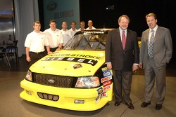 Bill Ford and Edsel Ford with Ford's Craftsman Truck Series drivers at an emplyee pep rally at Ford World Headquarters