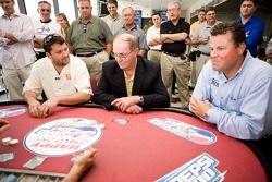 Tony Stewart talks poker with NASCAR Vice President of Corporate Communications Jim Hunter and Daytona International Speedway President Robin Braig