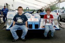 Young fans pose with the Autocon Motorsports Lola EX257 AER