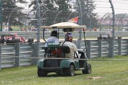 Jacques Villeneuve gets a lift back to the paddock