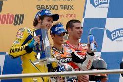 Podium: le vainqueur de la course Dani Pedrosa avec Valentino Rossi et Marco Melandri