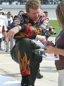 Bill Elliott checks his notes before qualifying