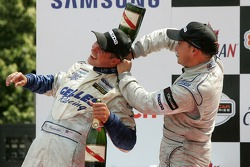 Podium: champagne shower for Robbie Pecorari