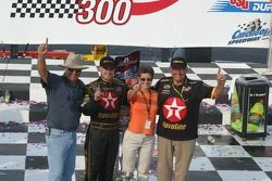 Casey Mears, his parents and his grandfather celebrate in Victory Lane