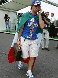 Jarno Trulli celebrates Italy's win at the World Cup