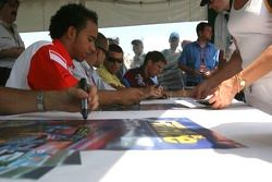 GP2 fans gather for the autograph session with Michael Ammermuller, Ernesto Viso, Gianmaria Bruni, L