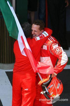 Race winner Michael Schumacher celebrates with Jean Todt