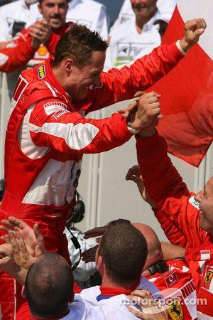 Race winner Michael Schumacher celebrates with his team