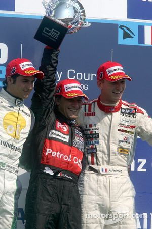 Giorgio Pantano celebrates victory on the podium with Nelson A. Piquet