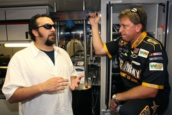 Matt Patricia, Linebacks coach for the New England Patriots, talks with Rayn Pemberton, crew chief of the #01 U.S. Army Chevrolet