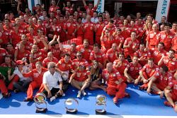 Race winner Michael Schumacher celebrates with Felipe Massa and Ferrari team members