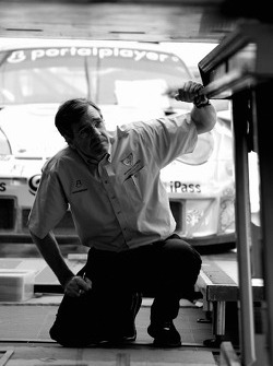 Flying Lizard Motorsports crew member at technical inspection