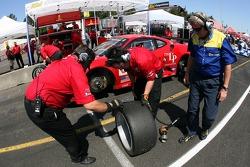 Risi Competizione crew members inspect tires