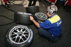 Michelin technician checks tires temperature