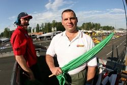 A Les Schwab Tires representative serves as the honorary starter